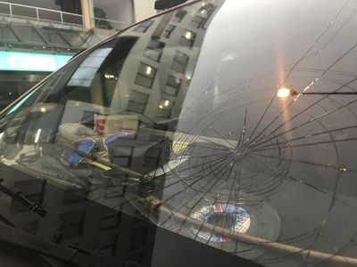 A cracked windshield from hail damage is seen in Sydney city.