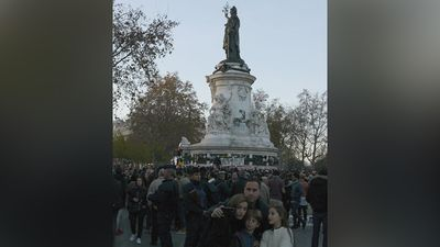 A French family pose for a selfie at Place de la Republique. (Jack Hawke, 9News.com.au)