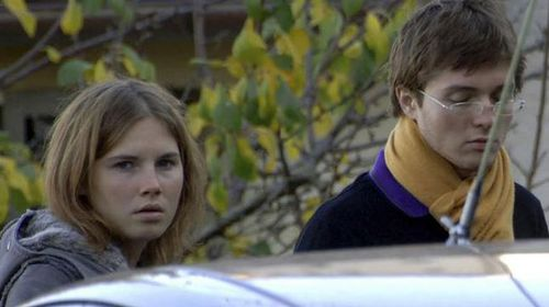Amanda Knox with Raffaele Sollecito pictured in 2007 outside the rented house where Meredith Kercher was found dead in Perugia, Italy. (AP)