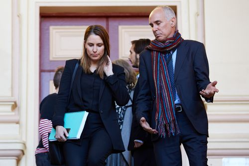 Quinn's lawyer Hannah MacDougall, with the accused's father outside of court.
