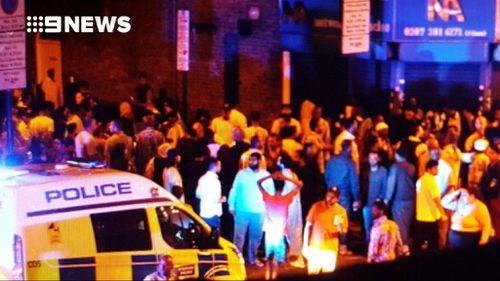 Crowds gathered near the mosque. (Twitter: @cynthiavanzella)