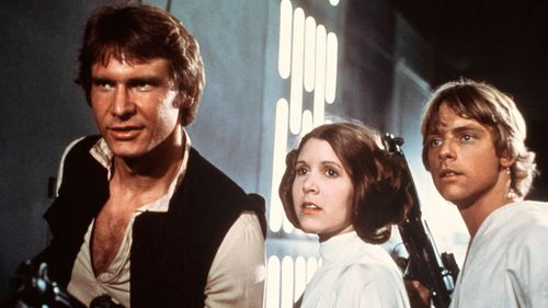 Fisher, in Star Wars: Episode IV - A New Hope, with co-stars Harrison Ford (left) and Mark Hamill.