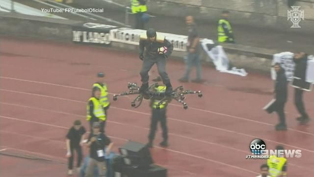 Daredevil rides drone to football match