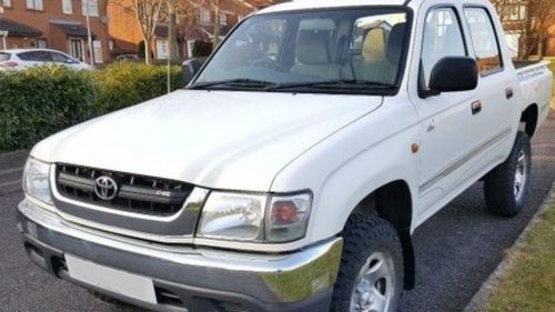 The white Toyota Hilux has the number-plate 098-HYX. (QLD Police)