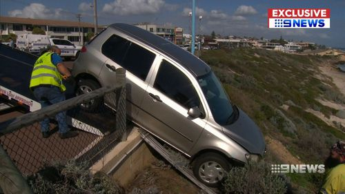 A mother and her two sons have narrowly avoided serious injury after their car flew over an embankment in Perth's north. Picture: 9NEWS
