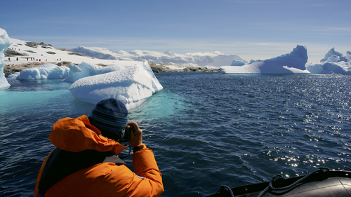 Tourist viewing an iceberg in Antarctica