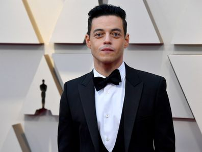 Rami Malek on the 2019 Oscars red carpet with a crooked bow-tie