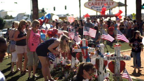 People visit a Las Vegas memorial dedicated to the 58 victims who were shot and killed by Stephen Paddock.