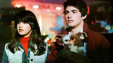 Gremlins stars Zach Galligan and Phoebe Cates.