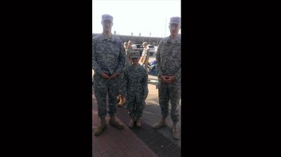 """In the army I've met some really tall people! One is 6'9"" the other is 6'10"". I am 4'11""."" (Facebook: Chelsea Grogan)"