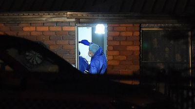 Police forensic investigators enter the house. (AAP)
