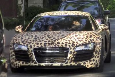 May 2013: According to TMZ, Justin has been 'wreaking havoc' on the streets of his exclusive Californian neighbourhood of Calabasas. The neighbours want Justin out for speeding his Ferrari around recklessly. In a move sure to annoy the neighbours, in July, Justin bought the tackiest Audi R8 you could find. It's leopard-print. 'Nuff said.<br/><br/>Image: Splash