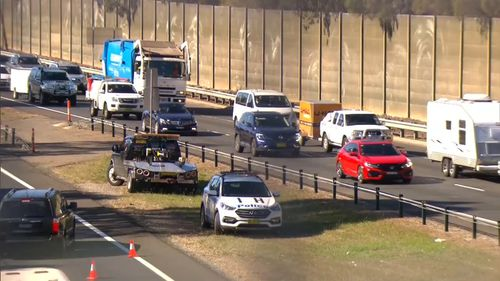 The man was attempting to cross the four-lane motorway around 10.50am before he was struck by the vehicle. Picture: 9NEWS.