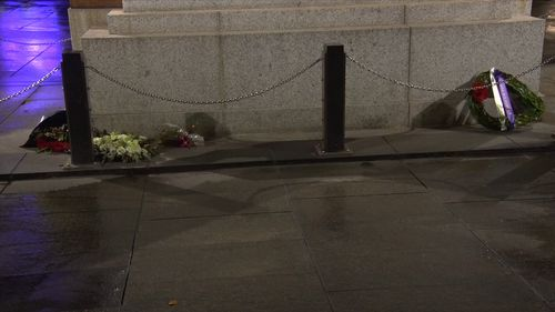 A man is alleged to have stolen flowers from a wreath and poured beer at the statue's feet. Picture: 9News