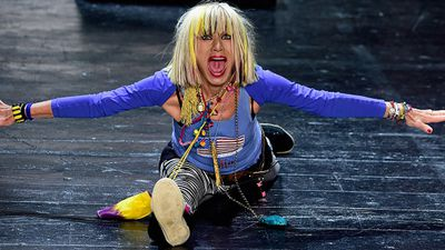 Designer Betsey Johnson putting on quite the show for her audience at her Spring 2016 runway show. (Getty)
