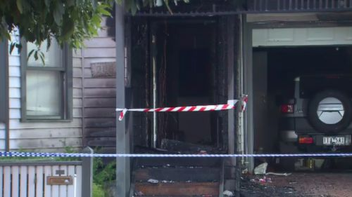 The home has been extensively damaged by fire and smoke.Police want to speak to this person. Picture: 9NEWS