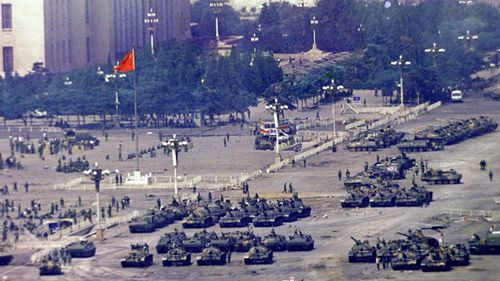 In this June 5, 1989 file photo, Chinese troops and tanks gather in Beijing, one day after the military crackdown that ended a seven week pro-democracy demonstration on Tiananmen Square. Hundreds were killed in the early morning hours of June 4.