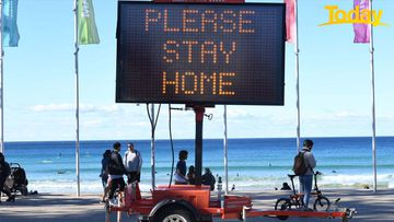 SYDNEY, AUSTRALIA - JULY 24: A digital warning sign asking people to stay at home in the suburb of Manly on July 24, 2021 in Sydney, Australia. New South Wales Premier Gladys Berejiklian declared a state of emergency as the state continues to report new community cases of the highly infectious Covid-19 delta variant. New South Wales is in the fourth week of a five-week lockdown and with cases on the rise, the lockdown is likely to be extended. (Photo by James D. Morgan/Getty Images)