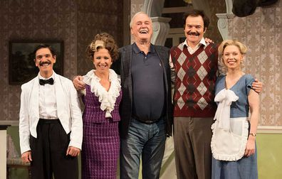 John Cleese (centre) who wrote the original BBC comedy series of Fawlty Towers with actors (from left to right) Syd Brisbane who plays Manuel, Blazey Best who plays Sybil, Stephen Hall who plays Basil and Aimee Horne who plays Polly.