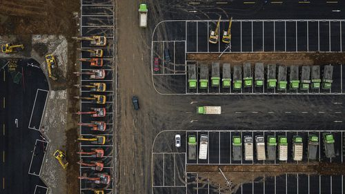 Construction machinery sits at the site of a field hospital on January 26, in Wuhan, Hubei province, China.