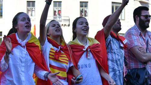 Protesters react as thousands of pro-unity protesters gather in Barcelona. (AAP)