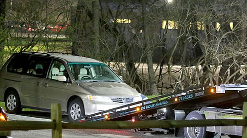 The Honda minivan is removed from the parking lot near the Seven Hills School campus in Cincinnati.(AP).