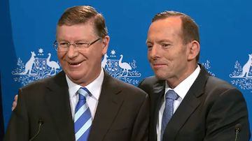 Premier Napthine and Prime Minister Abbott awkwardly embraced at a joint press conference in Melbourne. (9NEWS)