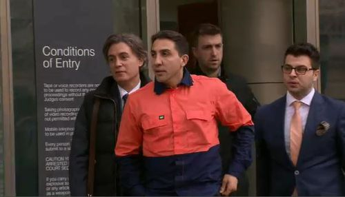 Acquaro (left) with Rocco Arico (orange shirt), one of his underworld figure clients. (Supplied)