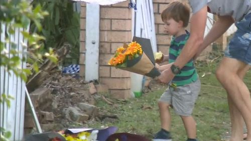 Members of the Beenleigh community were also seen laying flowers at the crash site.