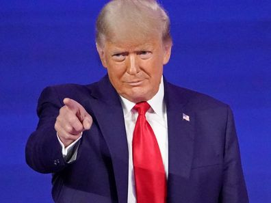Former president Donald Trump points to cheering supporters as he is introduced before speaking at the Conservative Political Action Conference in February.