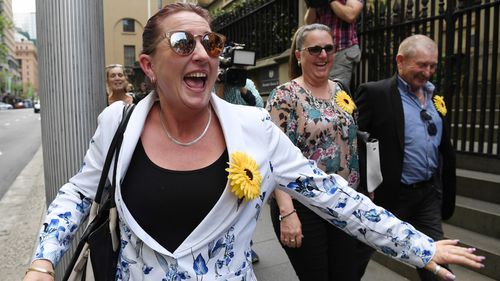 Jodie's sister Tracey Smith celebrates outside court. (AAP)
