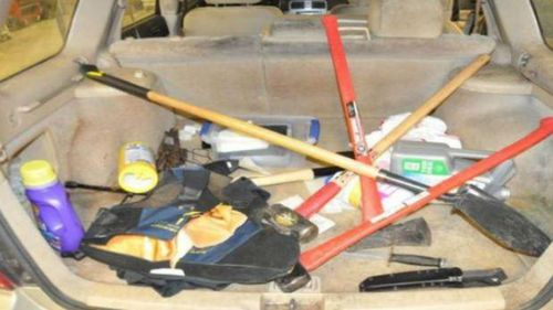 Some of the items found in the back off Falls' car, including handcuffs and a bulletproof vest.