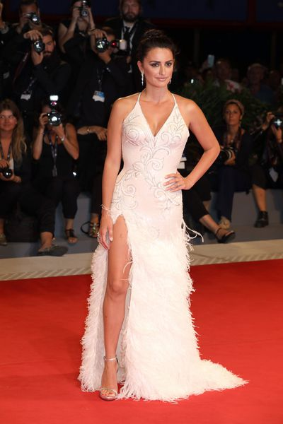"Penelope Cruz's greatest fears about taking on the role of Donatella Versace in the next instalment of American Crime Story appear to have been unfounded.<br> At the Venice Film Festival premiere of Loving Pablo, Cruz walked down the red carpet alongside husband Javier Bardem wearing an intricately embellished white gown from Atelier Versace.<br> The diplomatic dress choice took place only hours after the latest trailer for the eagerly-anticipated series also starring Ricky Martin and Darren Criss about the murder of Gianni Versace in 1997.<br> It seems that Cruz's conversation with Donatella, who took over the Versace empire following the death of her brother, worked.<br> ""I did have one conversation that was between she and I,"" Cruz told Entertainment Weekly. ""I don't want to say the details, but it was a long conversation.""<br> ""That was very important to me. I think she knows that the way I'm playing her, that I truly love her and respect her.""<br> <br> The dramatic Versace dress features feather trim and a slit to rival the European starlets stomping down the red carpet at the Venice Film Festival. See the best looks here.<br> <br>"
