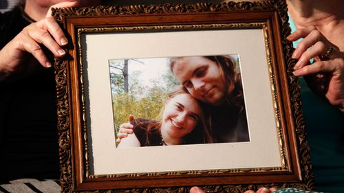 Linda Boyle and Lyn Coleman hold a photo of their married children, Canadian citizen Joshua Boyle and American citizen Caitlan Coleman. (AAP)
