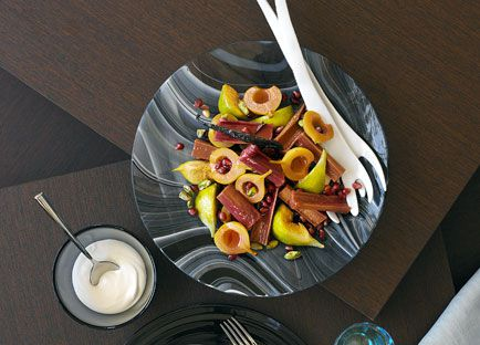 Autumn salad of pomegranate, pear and fig in rhubarb syrup