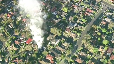 Eight people escape massive fire at Melbourne home