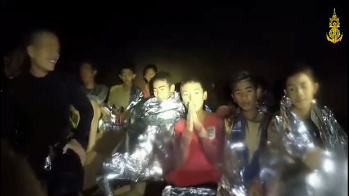 New footage has emerged from inside the cave of the 12 boys and their coach wrapped in foil blankets. In a video, they can be heard listing their names. Picture: Thai Navy Seals Facebook