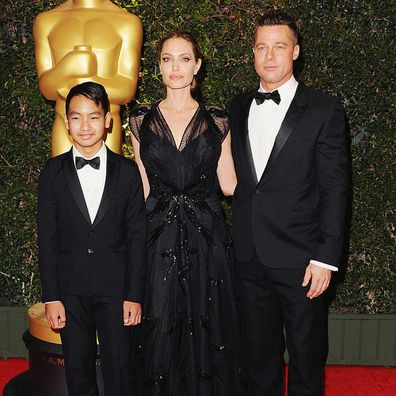 Angelina Jolie, Maddox Jolie-Pitt and actor Brad Pitt in 2013