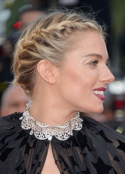 <p>Hair was parted in the middle, then braided either side in a glamorous milkmaid style. </p>