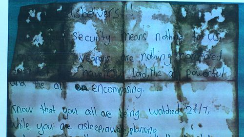 """A supplied image obtained Monday, May 1, 2017 of a photocopy of the bloodstained note left by the alleged murderer of Curtis Cheng. Crown prosecutor Paul McGuire SC told the court that a bloodstained note found on 15-year-old Farhad Jabar's body was clearly a reference to Mr Cheng's shooting being """"an act designed to cause terror and designed to achieve some religious motivation or end""""."""