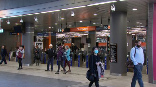 Commuters in Chatwood train station, in Sydney, begin their work commute as capacity is slashed on the city's trains, buses and ferries.