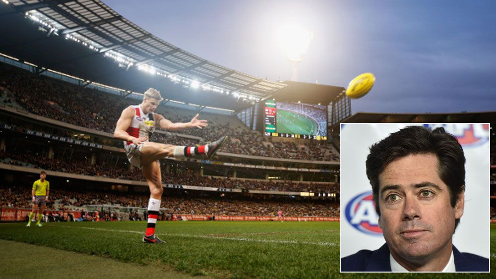 St Kilda's Nick Riewoldt takes a kick at the MCG and (inset) AFL boss Gillion McLachlan. (Getty and AAP)