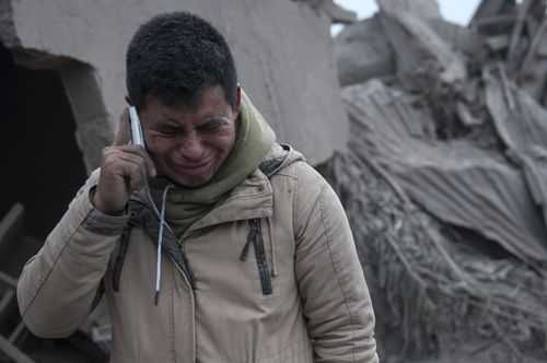 A man cries after seeing the remnants of his destroyed neighbourhood after the eruption of the Volcano of Fire in Guatemala. Picture: AAP