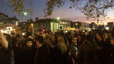 "<p>A 300-strong rally picketed Newtown's Town Hall Hotel overnight after a transgender woman was left bruised and bleeding in an alleged hate attack at the venue.</p><p> Scroll through to see more pictures of the event. </p><p> Stephanie McCarthy was still sporting two black eyes sustained on Friday as she addressed the crowd who had gathered in her support.</p><p> ""I'm just one of a long line of people who have been bashed just for being who we are,"" she said.</p><p> ""Lives are getting destroyed … and if we don't do something someone is going to die on these streets.""</p><p> Andy Zephyr, a transgender woman at the protest, said she was subjected to abuse almost daily in Newtown – a neighbourhood once considered a safe haven for the LGBTI community.</p><p> ""It's really sad, but I was kind of expecting a trans woman to be brutally bashed eventually,"" she said.</p><p> ""I get harassed weekly. I don't leave the house too often wearing the clothes I want to wear, but I know when I do someone is going to say something or intimidate me or hurt me.</p><p> ""It's not just alcohol-fuelled violence, it's gendered violence.""</p><p> Several others at the protest reported similar abuse, which they said had intensified since the introduction of Sydney's CBD lock-out laws.</p><p> Ms McCarthy, bassist for Sydney band Love Maul, was reportedly bashed at the ""Townie"" on Friday night as she waited to perform with her band.</p><p> ""There was four or five of them following me around, yelling 'faggot' at me. One of them kept deliberately bumping into me. I had my ponytail pulled a couple of times,"" she told the <a href=""http://www.smh.com.au/nsw/newtown-bashing-of-transgender-woman-stokes-fears-among-lgbti-community-20150608-ghjd8v.html?utm_source=twitter&utm_medium=social&utm_campaign=nc&eid=socialn:twi-13omn1677-edtrl-other:nnn-17/02/2014-edtrs_socialshare-all-nnn-nnn-vars-o&sa=D&usg=ALhdy28zsr6qiq""><i>Sydney Morning Herald</i></a>.</p><p> Ms McCarthy allegedly confronted the men verbally over the abuse. </p><p>She claims one of the group grabbed her by the shirt. She grabbed the man's shirt in return before being punched repeatedly in the face.</p><p> She accused venue security of turning a blind eye to the attack, and of allowing the alleged offenders to escape. </p><p> ""One of the security guards was standing five metres away behind a glass door which he didn't even open. He ran downstairs, leaving me to get bashed,"" she said.</p><p> Yesterday, the Townie apologised for the ""shocking and deeply regrettable"" incident, adding that it had turned over all information and CCTV to police.</p><p> Investigations are continuing. <i>Picture: Twitter/@ElizaJBarr</i></p>"