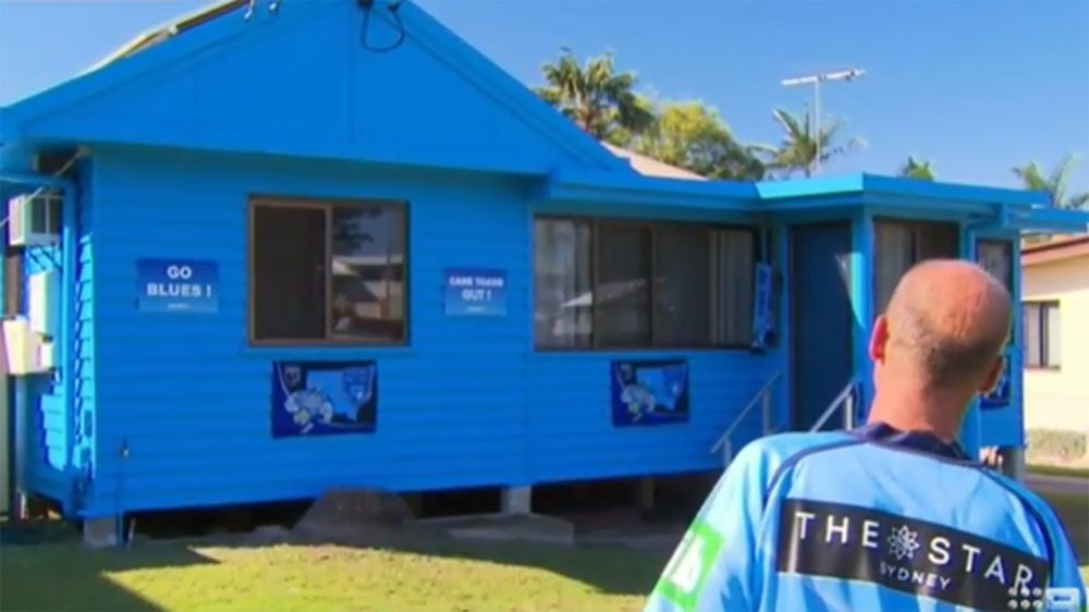 NSW fan paints Brisbane house blue in the lead up to State of Origin opener