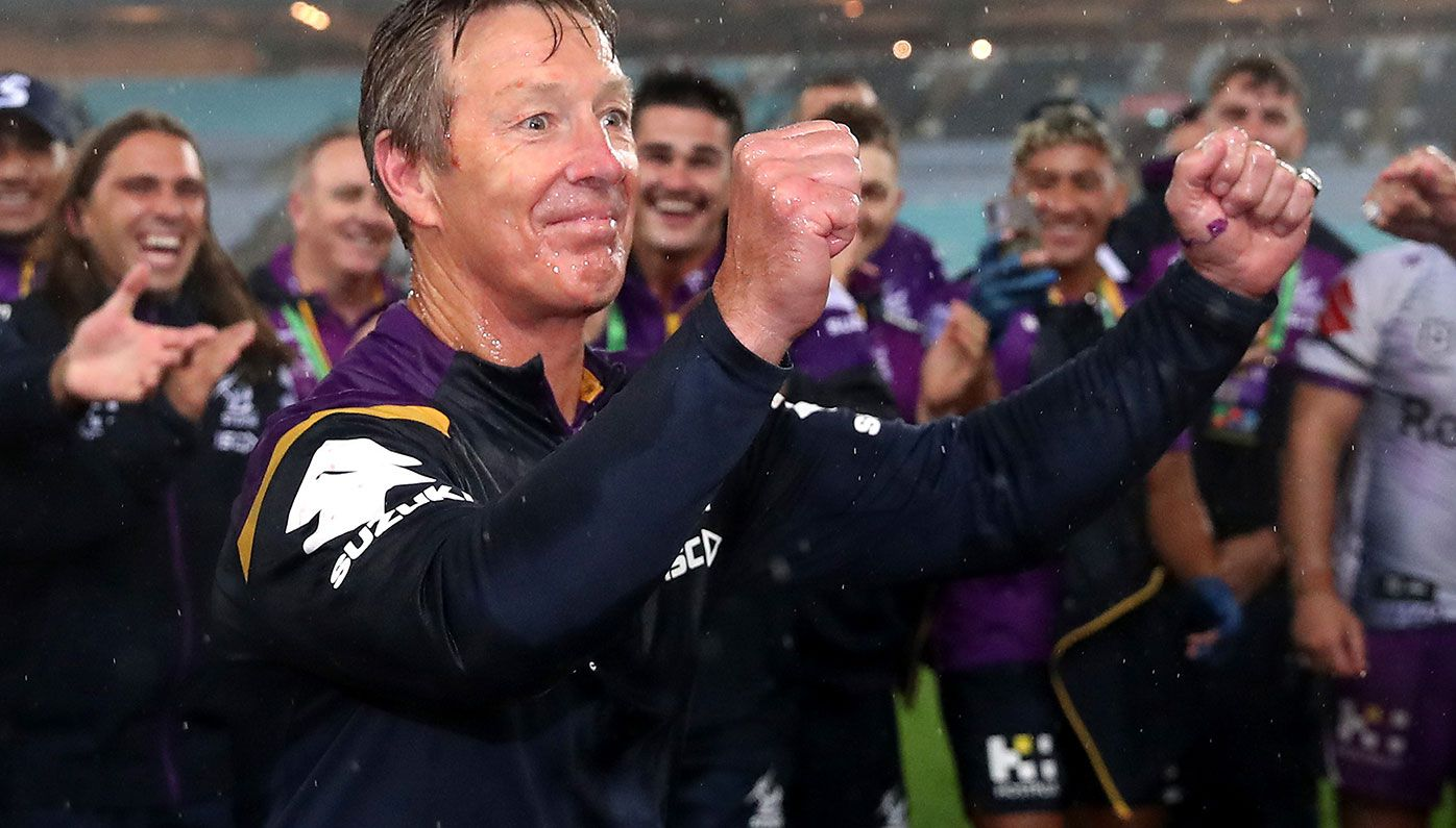 Craig Bellamy celebrates Melbourne's premiership win over Penrith.