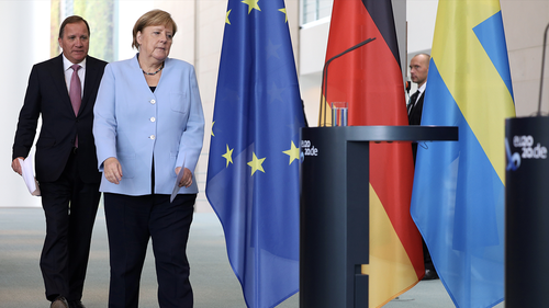German Chancellor Angela Merkel and Sweden's Prime Minister Stefan Lövfen arrive to address the media during a joint press conference as part of a meeting on September 3, 2020 in Berlin, Germany. (Photo by Yann Bombeke-Pool/Getty Images)