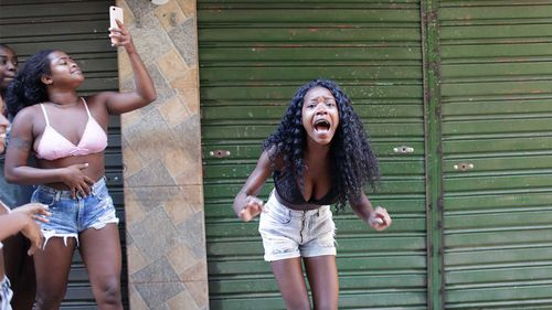 Residents protest a police operation targeting drug traffickers in the Jacarezinho favela of Rio de Janeiro.