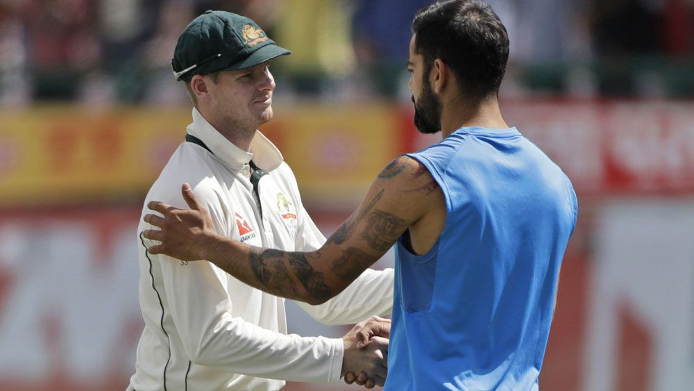 Australia's Steve Smith shakes hands with India's Virat Kohli after Test series loss
