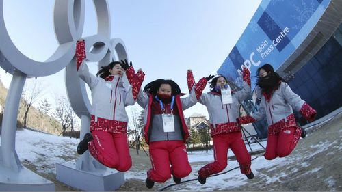 Volunteer workers celebrating in Pyeongchang ahead of the Winter Olympics in February. (AAP)
